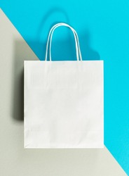 white paper shopping bag on colorful background