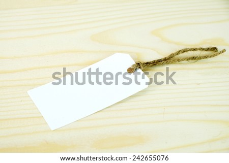 White paper tag on wood