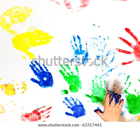White paper with child handprints