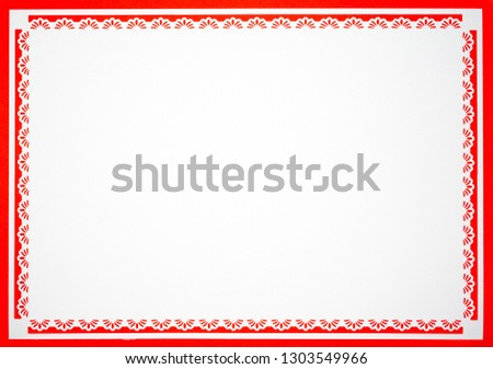 White paper with floral patterns on the edge in red background #1303549966