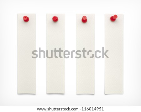 White paper with red pin on white background