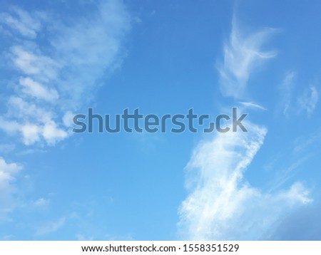 White parallel contrails of planes on the background of the blue sky. Contrails (condensation trails or vapour trails) are line-shaped clouds produced by aircraft engine exhaust or changes in air pre