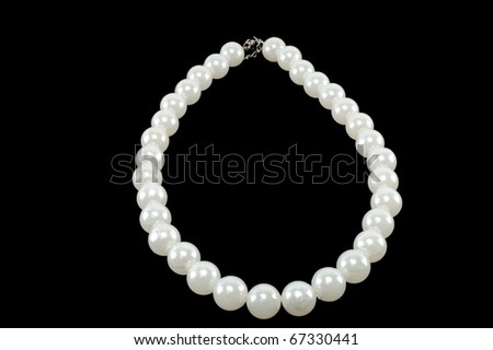 white pearl necklace on a black background