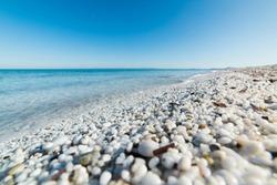 white pebbles and turquoise sea in Le Saline beach, Sardinia