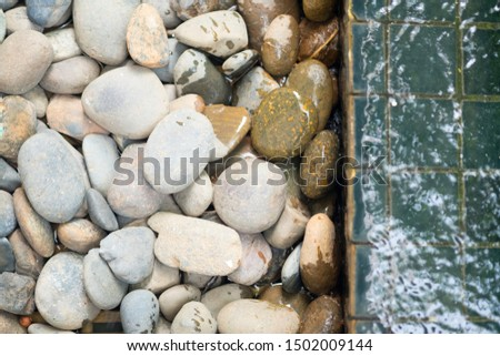 White pebbles for background and texture. Rock or stone pebble