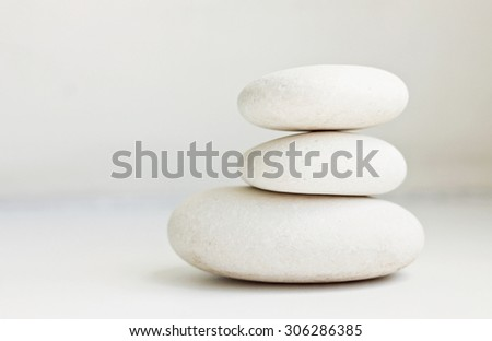 white pebbles pile white background pure simplicity empty soft focus