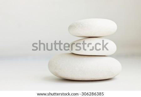 white pebbles pile white background pure simplicity empty soft focus