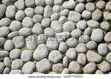 White pebbles stone background. Relaxation, meditation and calmness around us. White pebbles stone texture and background