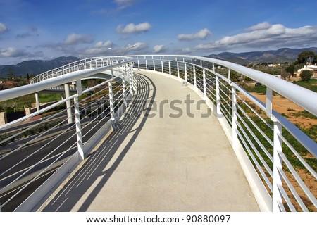 White pedestrian bridge over a highway in Majorca (Spain)