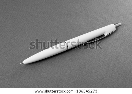 white pen on a gray background