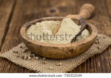 White Pepper on rustic wooden background as close-up shot #730312144