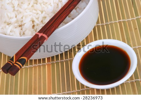 white persian rice on decorative carpet with soy sauce