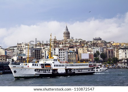 white pessenger ship in Bosphorus with Galata Tower background, istanbul, Turkey