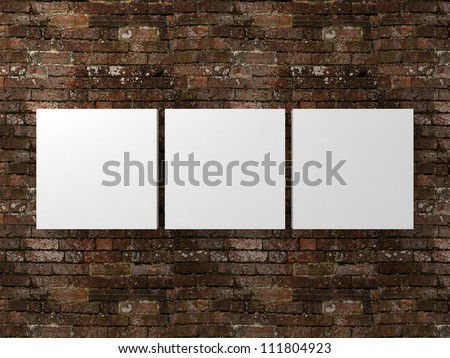 white photo frames on dirty old brick wall