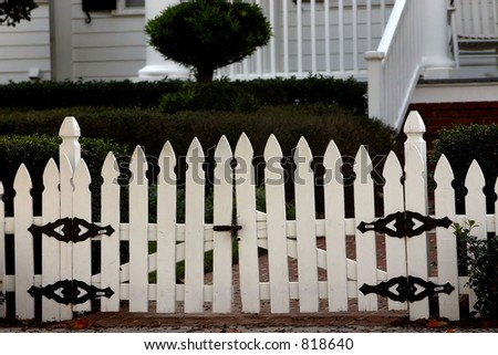 white picket fence in front of residence