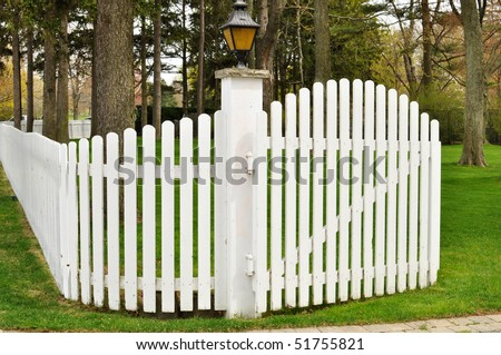 White picket fence with a gate