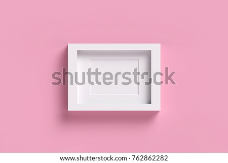 White picture frame on pink pastel background. sweet picture frame concept.