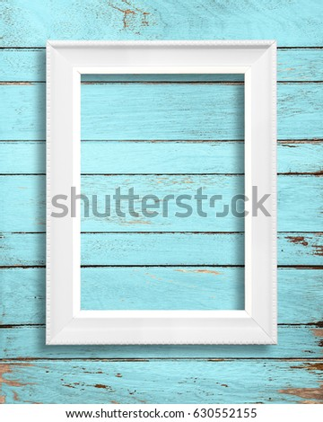 White picture frame on vintage wood wall.