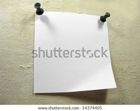 White piece of notice paper over a old canvas background
