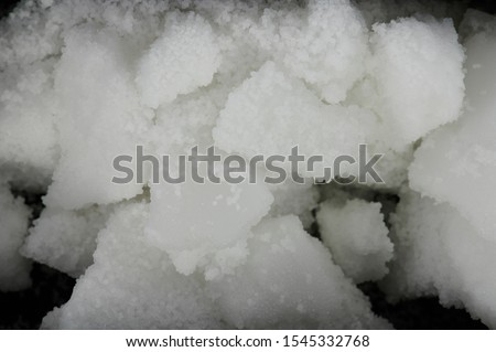 White pieces of wax parts with small granules. Blocks of organic wax