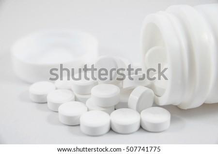 white pill on white blackground with bottle #507741775