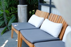 white pillow gray cushion on wooden chair for relaxing outdoor