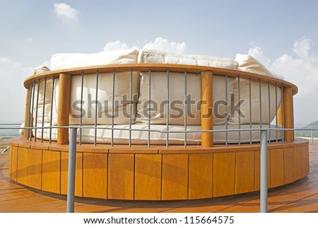 White pillow on a chair with canopy