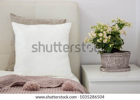 White pillow on bed in a cozy bedroom, Mockup