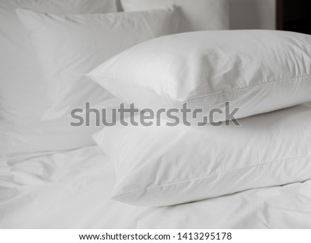 White pillows, duvet and duvetcase in a bed. White bedlinen on a white bed. #1413295178