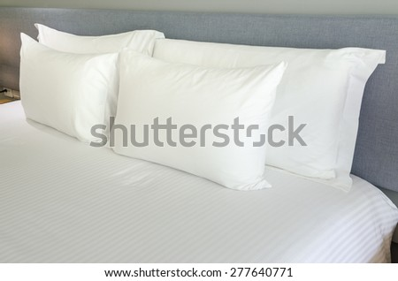 White pillows on a bed Comfortable soft pillows on the bed.