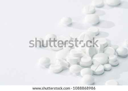 white pills and tablets isolated on white background macro #1088868986