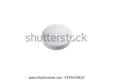 White pills on a white background. A small round mass of solid medicine. Zdjęcia stock ©