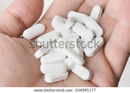 White pills on hand