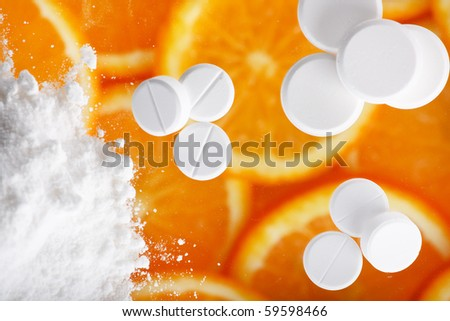 white pills with oranges