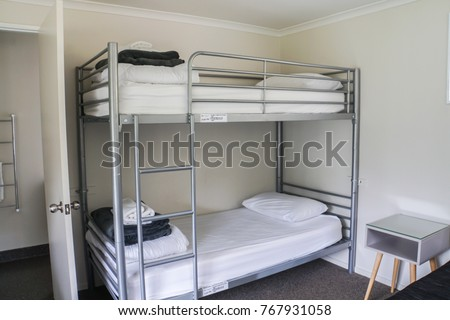 white plain bunk bed in dormitory