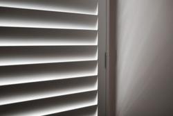 White plantation shutters in bedroom