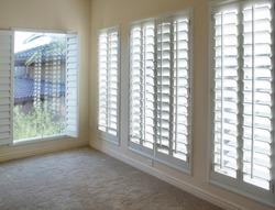 White plantation style wood Shutters for luxury Interior Design in condo.
