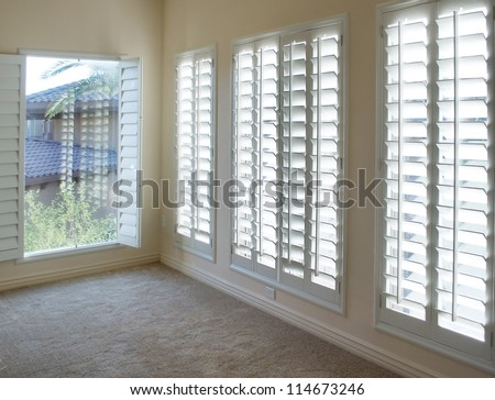 White plantation style wood Shutters for luxury Interior Design in condo. #114673246