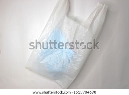 White plastic bag in blue on white background