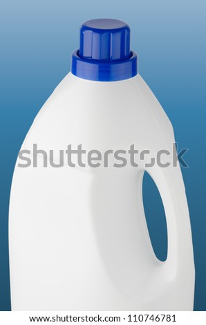 White plastic bottle with blue cap on blue background.