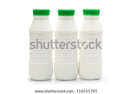 white plastic bottles with yogurt stand on table