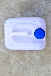 White plastic canister with blue lid in different positions