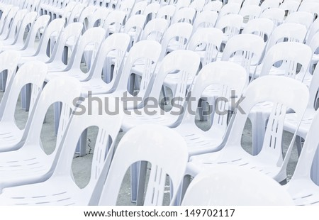 White plastic chairs in celebration and outdoor event