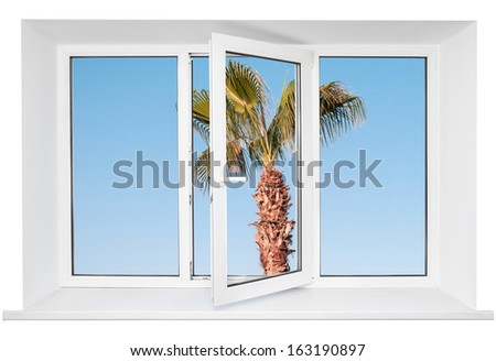 White plastic triple door window with palm tree on blue sky through glass. Isolated on white background. Opened door