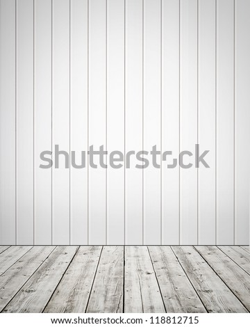 White plastic wall with wooden floor background - stock photo