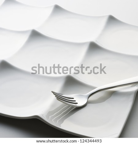 white plate and fork #124344493