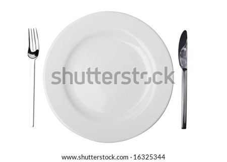 White plate, fork and table knife isolated on white with clipping path