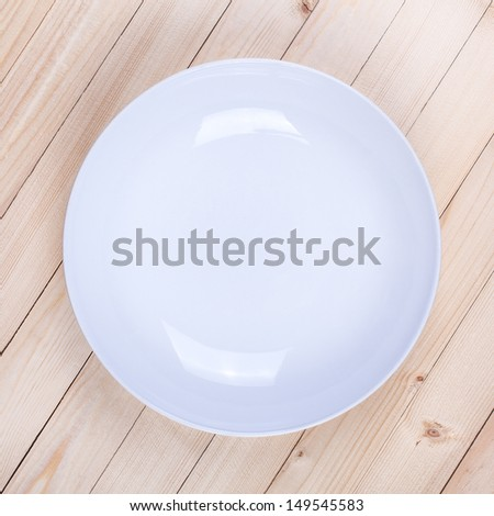 White plate on wooden table