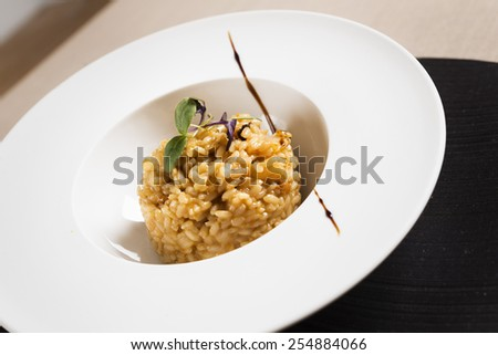 White plate with a nice presentation of a typical Mediterranean rice