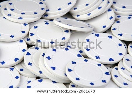 white poker chips on a table